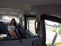 Brunette with big fake tits and latex skirt squirting in the cab